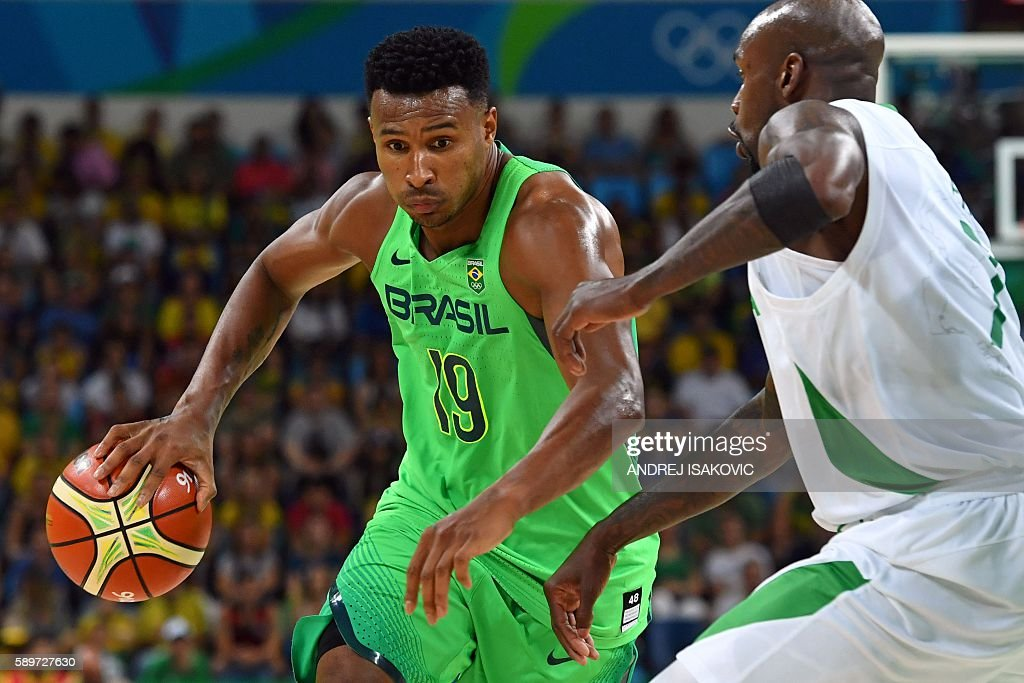 Brazil's shooting guard Leandro Barbosa works around Nigeria's small forward AlFarouq Aminu during a Men's round Group B basketball match between...