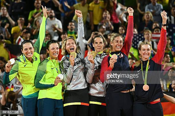 Brazil's silver medallists Agatha Bednarczuk and Barbara Seixas De Freitas Germany's gold medallists Laura Ludwig and Kira Walkenhorst and USA's...