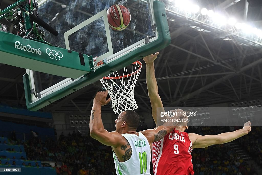 TOPSHOT Brazil's small forward Alex Garcia and Croatia's forward Dario Saric go for a rebound during a Men's round Group B basketball match between...