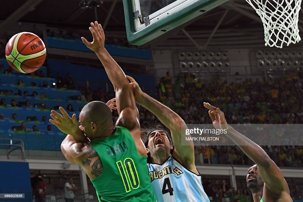 TOPSHOT Brazil's small forward Alex Garcia Argentina's power forward Luis Scola and Brazil's centre Nene Hilario go for a rebound during a Men's...