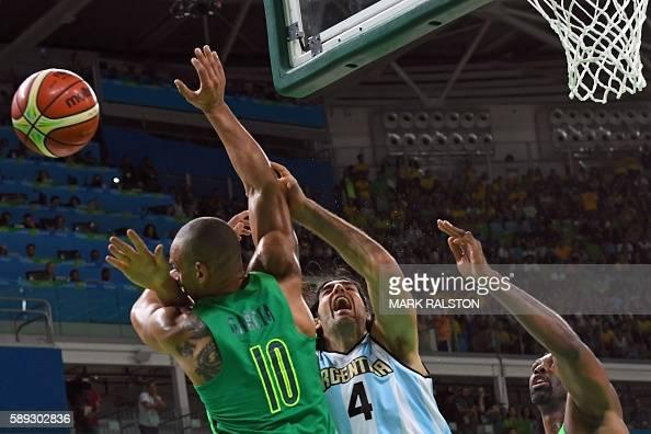 TOPSHOT Brazil's small forward Alex Garcia Argentina's power forward Luis Scola and Brazil's centre Nene Hilario go for a rebound during a Men's...