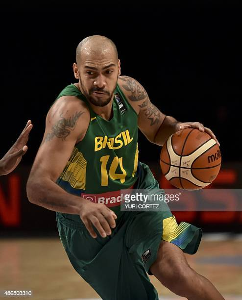 Brazil's small forward Viera Marquinhos evades Panama's centre Leonardo Pomare during their 2015 FIBA Americas Championship Men's Olympic qualifying...