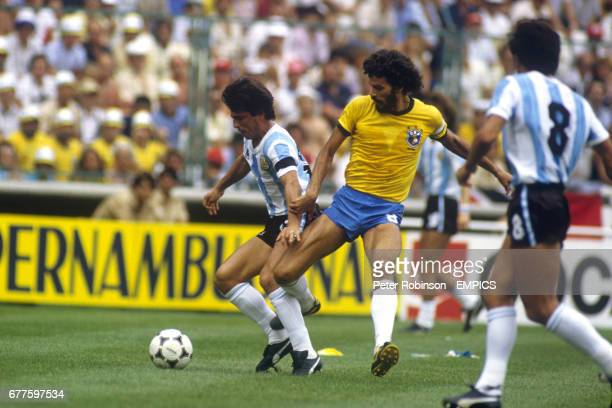 Brazil's Socrates tries to tackle Argentina's Daniel Passarella