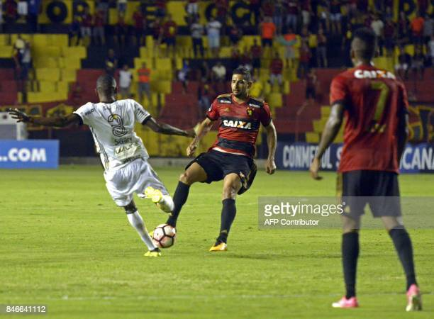 Brazil's Sport Recife Diego Souza vies for the ball with Brazil's Ponte Preta Marllon during the Copa Sudamericana football tournament match at Ilha...