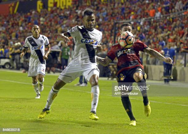 Brazil's Sport Recife footballer Eugenio Mena vies for the ball with Brazil's Ponte Preta Fernando Bob during the Copa Sudamericana football...