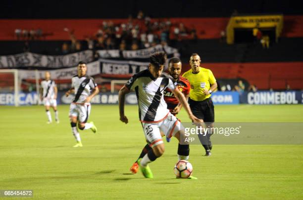 Brazil's Sport Recife player Samuel Xavier vies for the ball with Uruguay's Danubio player Joaquin Ardaiz during their Copa Sudamericana 2017...