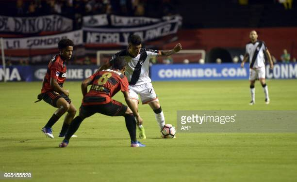 Brazil's Sport Recife players Everton Felipe and Rithely vie for the ball with Uruguay's Danubio player Joaquin Ardaiz during their Copa Sudamericana...