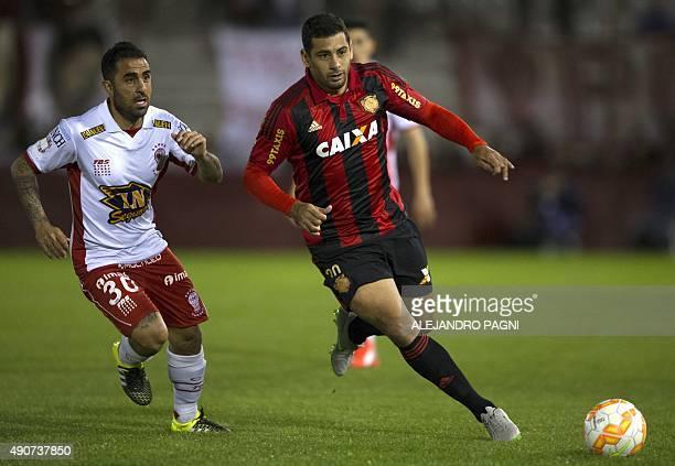 Brazil's Sport Recife's midfielder Diego Souza vies for the ball with Argentina's Huracan's midfielder Daniel Montenegro during their Copa...