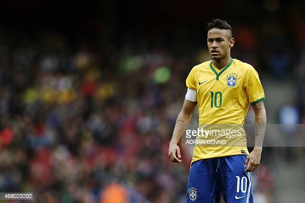 Brazil's striker Neymar looks on during the friendly international football match between Brazil and Chile at The Emirates Stadium in London on March...