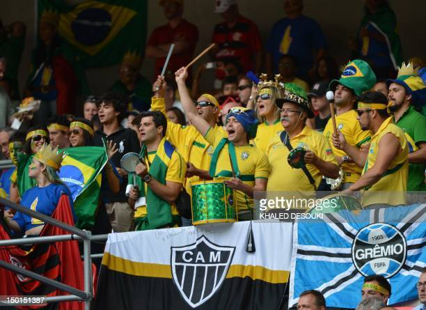 Brazil's supporters cheer their team during the men's football final match between Brazil and Mexico at Wembley stadium during the London 2012...