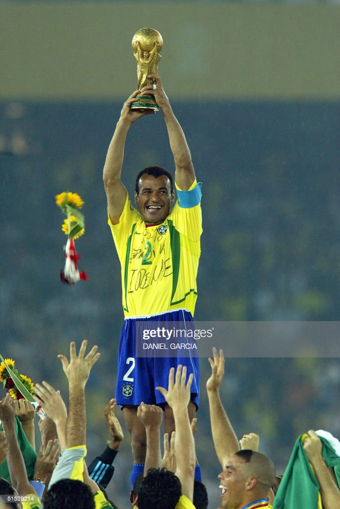 Brazil's team captain and defender Cafu hoists the World Cup trophy during the award ceremony at the International Stadium Yokohama Japan 30 June...