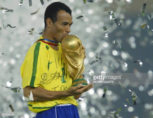 Brazil's team captain and defender Cafu kisses the World Cup trophy celebrating Brazil's 20 victory over Germany in match 64 of the 2002 FIFA World...