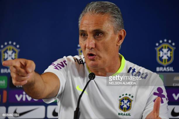 Brazil's team coach Tite gestures during a press conference after a training session on the eve of their 2018 FIFA Russia World Cup qualifier...