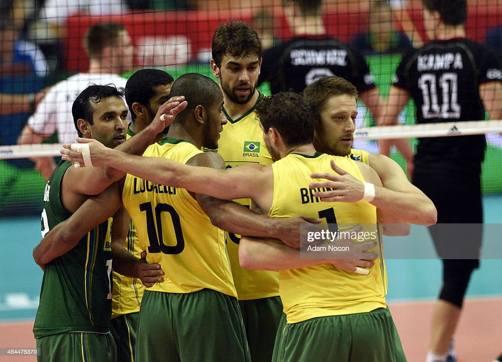 Brazil's team hugs during the FIVB World Championships match between Brazil and Germany on September 1, 2014 in Katowice, Poland.