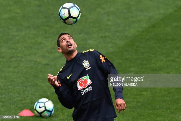 Brazil's team player Diego Souza takes part in a training session on the eve of their 2018 FIFA Russia World Cup qualifier football match against...