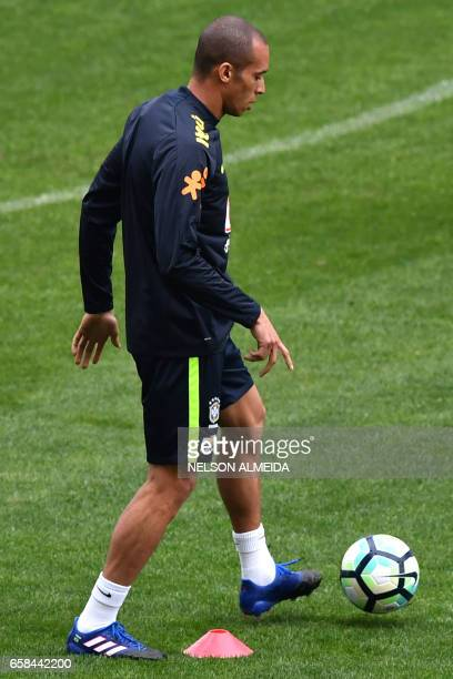 Brazil's team player Miranda takes part in a training session on the eve of their 2018 FIFA Russia World Cup qualifier football match against...