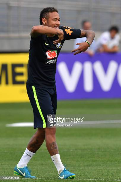 Brazil's team player Neymar gestures during a training session at the Gremio team training centre in Porto Alegre Brazil on August 28 2017 ahead of...