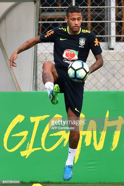 Brazil's team player Neymar takes part in a training session at the Gremio team training centre in Porto Alegre Brazil on August 28 2017 ahead of...