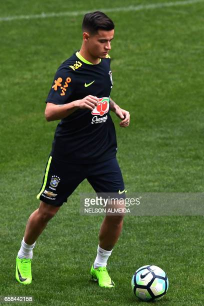 Brazil's team player Philippe Coutinho takes part in a training session on the eve of their 2018 FIFA Russia World Cup qualifier football match...