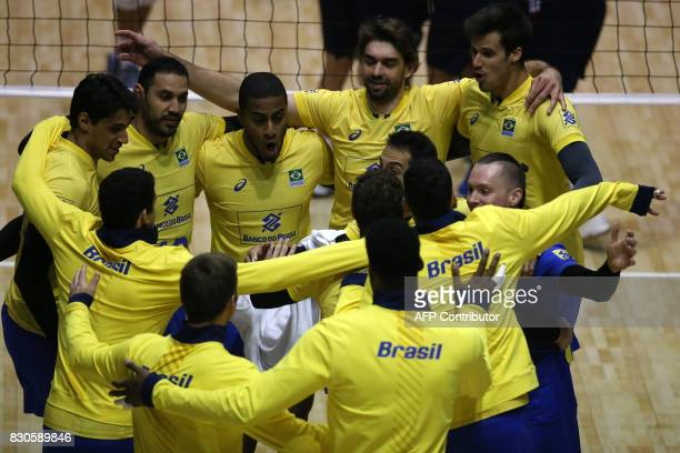 Brazil's team players celebrate after defeating Venezuela in their Men's South American Volleyball Championship final in Santiago on August 11 2017 /...