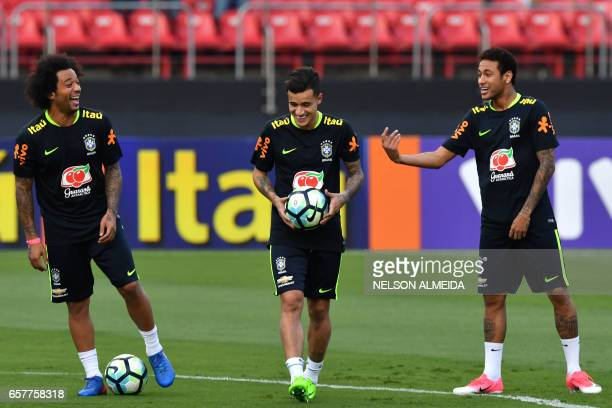 Brazil's team players Marcelo Philippe Coutinho and Neymar take part in a training session at the Morumbi stadium in Sao Paulo Brazil on March 25...