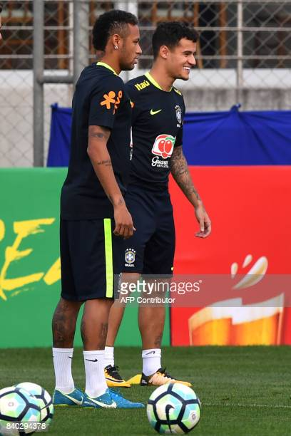 Brazil's team players Neymar and Philippe Coutinho take part in a training session at the Gremio team training centre in Porto Alegre Brazil on...