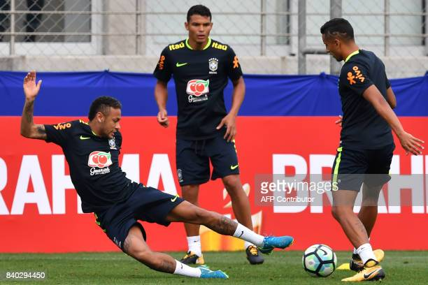 Brazil's team players Neymar Thiago Silva and Marquinhos take part in a training session at the Gremio team training centre in Porto Alegre Brazil on...