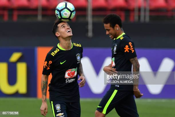 Brazil's team players Philippe Coutinho and Neymar take part in a training session at the Morumbi stadium in Sao Paulo Brazil on March 25 2017 ahead...