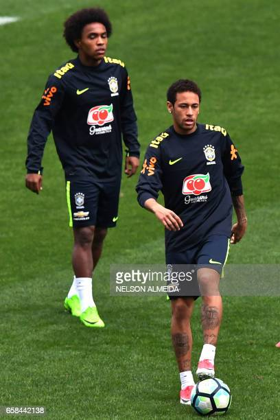 Brazil's team players Willian and Neymar take part in a training session on the eve of their 2018 FIFA Russia World Cup qualifier football match...