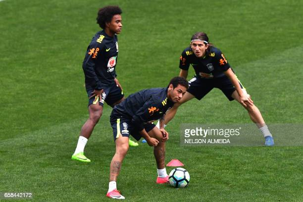 Brazil's team players Willian Neymar and Filipe Luis take part in a training session on the eve of their 2018 FIFA Russia World Cup qualifier...