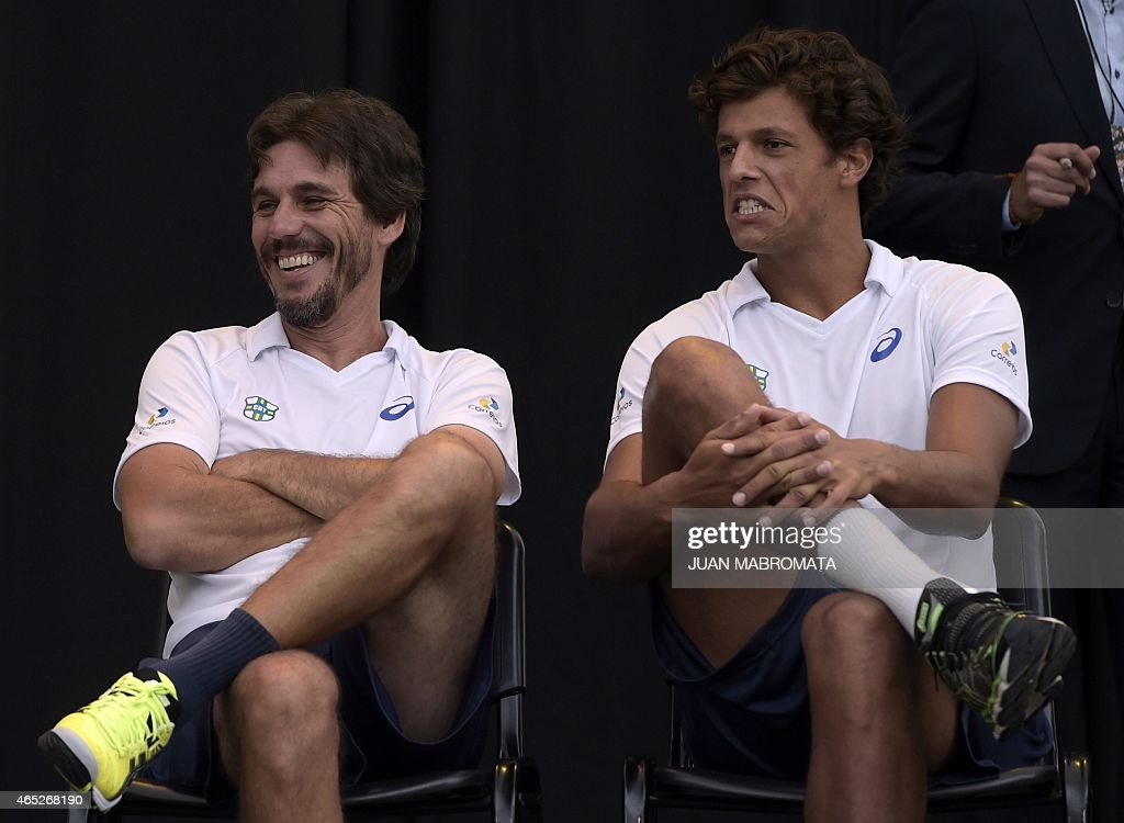 Brazil's tennis captain Joao Zwetsch (L) and tennis player <a gi-track='captionPersonalityLinkClicked' href=/galleries/search?phrase=Joao+Souza+-+Brazilian+Tennis+Player&family=editorial&specificpeople=7935783 ng-click='$event.stopPropagation()'>Joao Souza</a> gesture during the draw ahead their Davis Cup World Group 1st Round singles tennis match in Villa Martelli, Buenos Aires, Argentina on March 5, 2015.