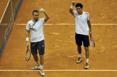 Brazil's tennis player Andre Sa and Slovakia's Michal Mertinak celebrate their victory against Italy's Daniele Bracciali and Potito Starace during...