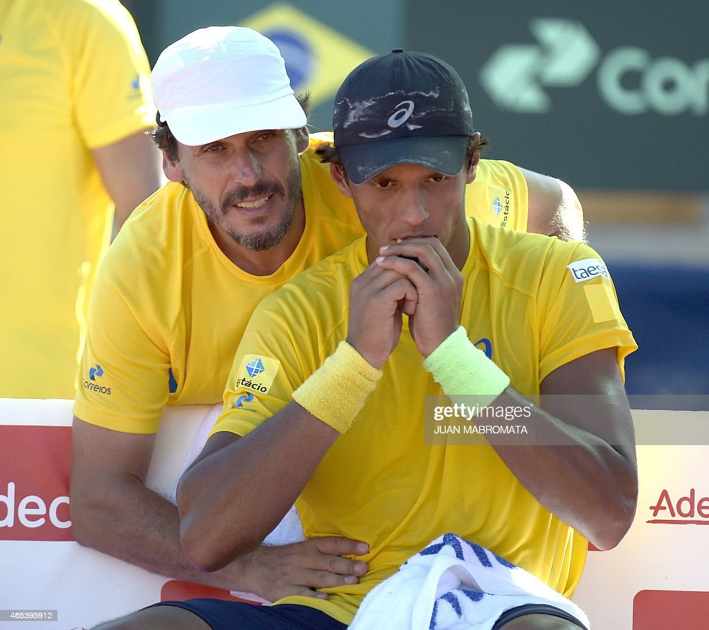 Brazil's tennis player <a gi-track='captionPersonalityLinkClicked' href=/galleries/search?phrase=Joao+Souza+-+Brazilian+Tennis+Player&family=editorial&specificpeople=7935783 ng-click='$event.stopPropagation()'>Joao Souza</a> (front) receives a massage from Brazil's team captain Joao Zwetsch during his Davis Cup World Group 1st Round single tennis match against Argentine Carlos Berlocq in Villa Martelli, Buenos Aires, Argentina on March 6, 2015. Souza won 6-4, 3-6, 5-7, 6-3 and 6-2.