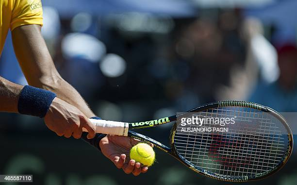 Brazil's tennis player Joao Souza serves to Argentina's Leonardo Mayer during their Davis Cup World Group first round singles match in Villa Martelli...