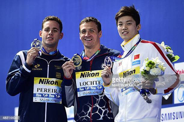 Brazil's Thiago Pereira USA's Ryan Lochte and China's Wang Shun pose during the podium ceremony for the men's 200m individual medley swimming event...
