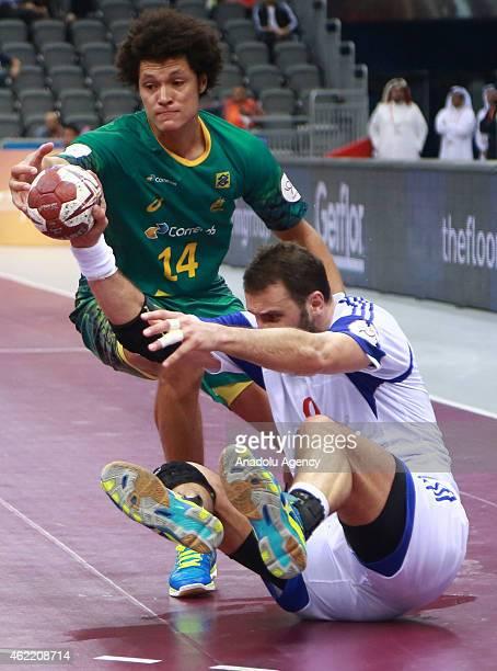Brazil's Thiagus Santos in action against Croatia's Igor Vori during the 24th Men's Handball World Championships Eighth Final EF7 match between...