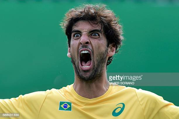TOPSHOT Brazil's Thomaz Bellucci celebrates after winning against Belgium's David Goffin during their men's singles third round tennis match at the...