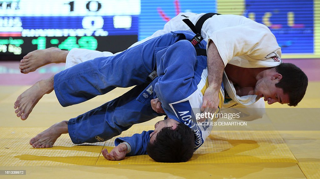 Brazil's Victor Penalber (R) fights against Russia's Alan Khubetsov on February 10, 2013 in their men's 81kg category qualifying fight on February 10, 2013 during the Paris International Judo tournament, part of the Grand Slam, at the Palais Omnisports de Paris-Bercy (POPB).