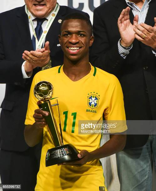 Brazil´s Vinicius Junior poses with the best player trophy in the South American U17 football tournament in Rancagua some 90 km south of Santiago de...