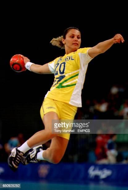 Brazil's Viviani Emerick puts her full weight behind a shot on the Denmark goal