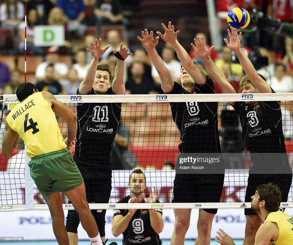 Brazil's Wallace de Souza attacks German's defense: Lukas Kampa, Marcus Bohme, and Sebastian Schwarz during the FIVB World Championships match between Brazil and Germany on September 1, 2014 in Katowice, Poland.