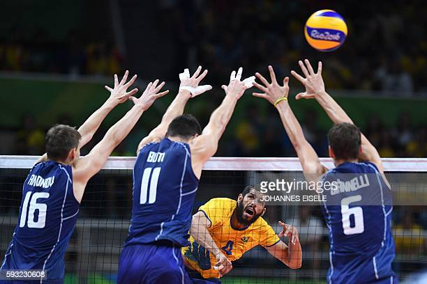 TOPSHOT Brazil's Wallace Leandro De Souza spikes the ball during the men's Gold Medal volleyball match between Italy and Brazil at the Maracanazinho...