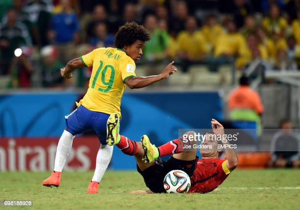 Brazil's Willian and Mexico's Rafael Marquez battle for the ball
