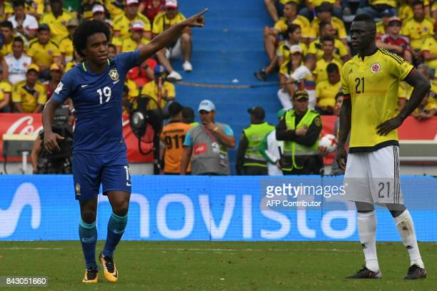 Brazil's Willian celebrates after scoring against Colombia as Colombia's Davinson Sanchez looks on during their 2018 World Cup football qualifier...