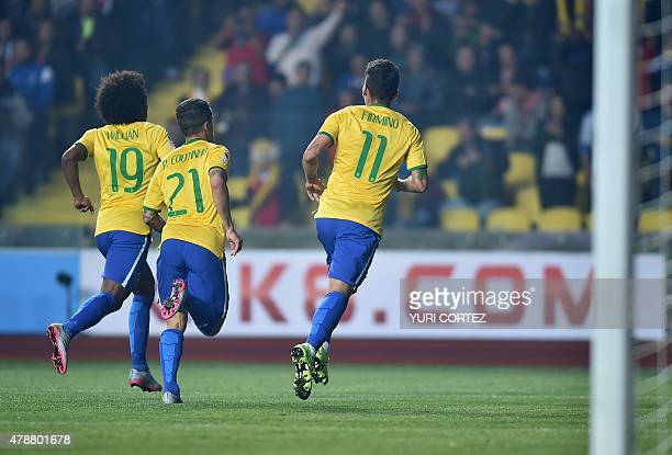 Brazil's Willian Philippe Coutinho and Roberto Firmino run to celebrate with forward Robinho after he scored against Paraguay during their 2015 Copa...