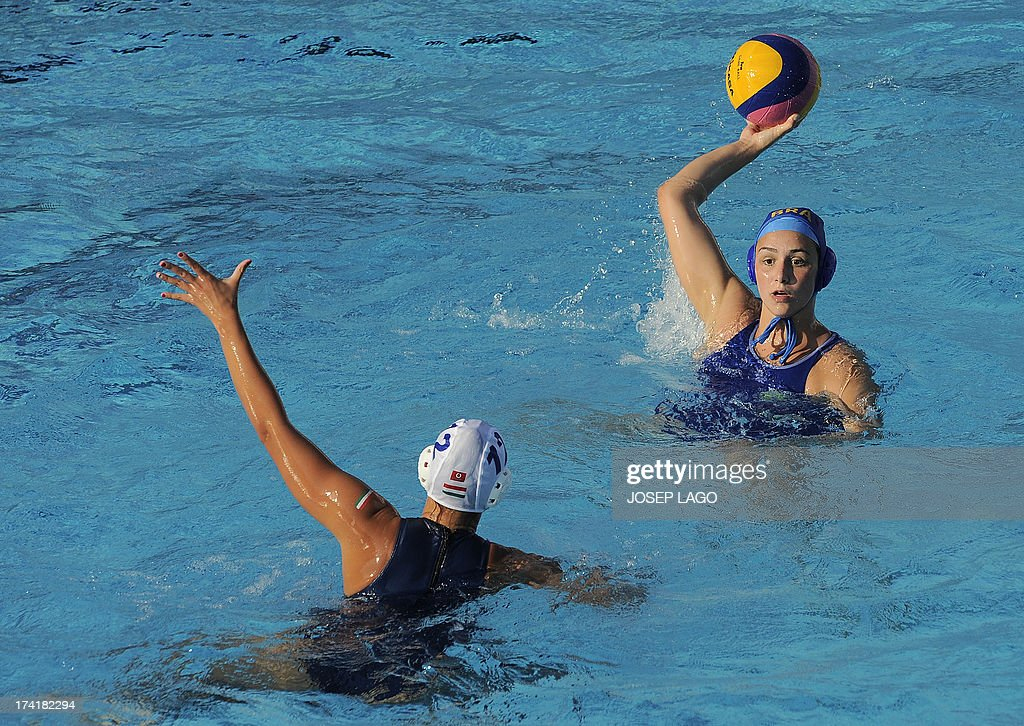 Brazl's Mirella Coutinho (up) tries to throw past Hungary's Kata Maria Menczinger (down) during their preliminary round match of the women's water polo competition at the FINA World Championships in Bernat Picornell pools in Barcelona on July 21, 2013. Hungary won the match 20-6.