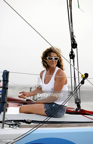 French Florence Arthaud sits on 'Deep blue' 13 May 2007 before arriving at the end of the second edition of the Route de l'Equateur a 4500 miles...
