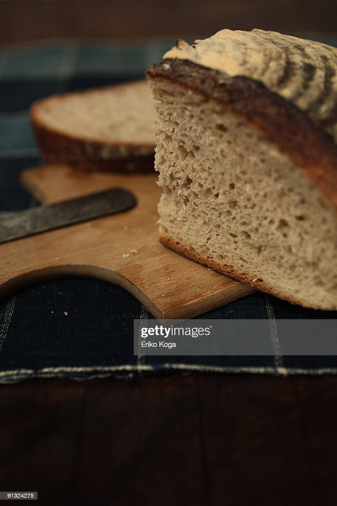 Bread and knife on cutting board  : Stock Photo