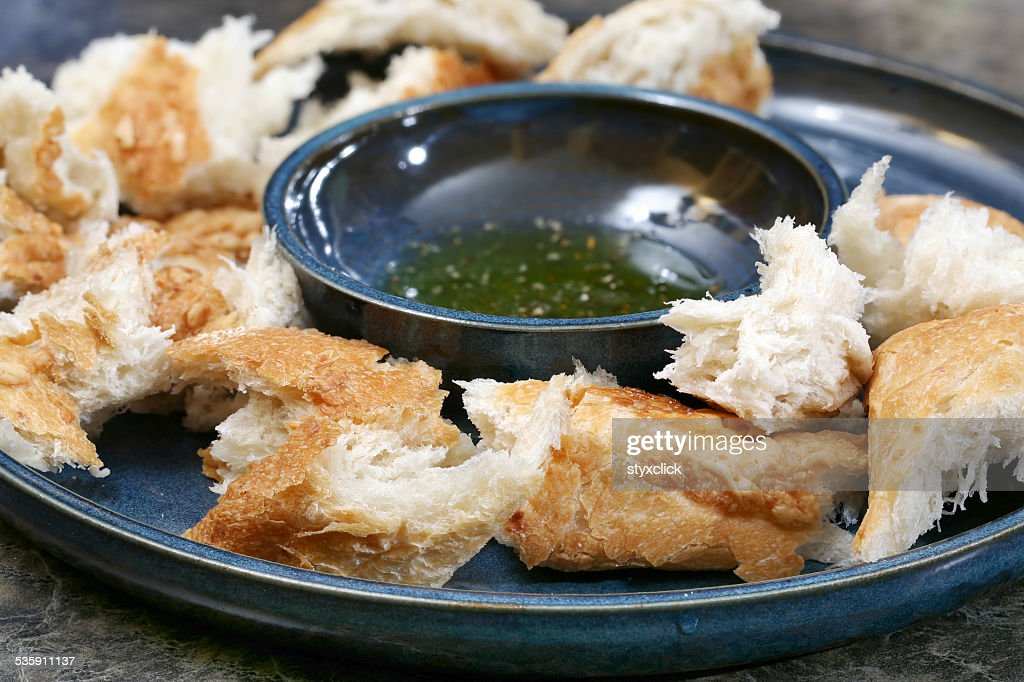 Bread and olive oil with spices : Stock Photo