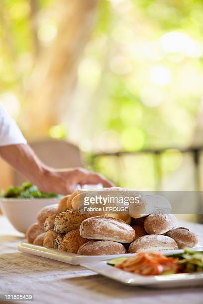 Bread and salad served on a table